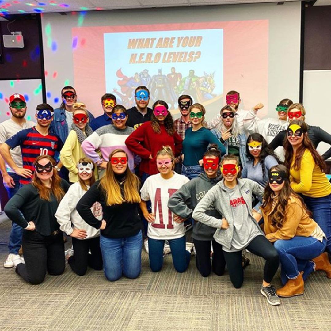 Students in dress in superhero gear