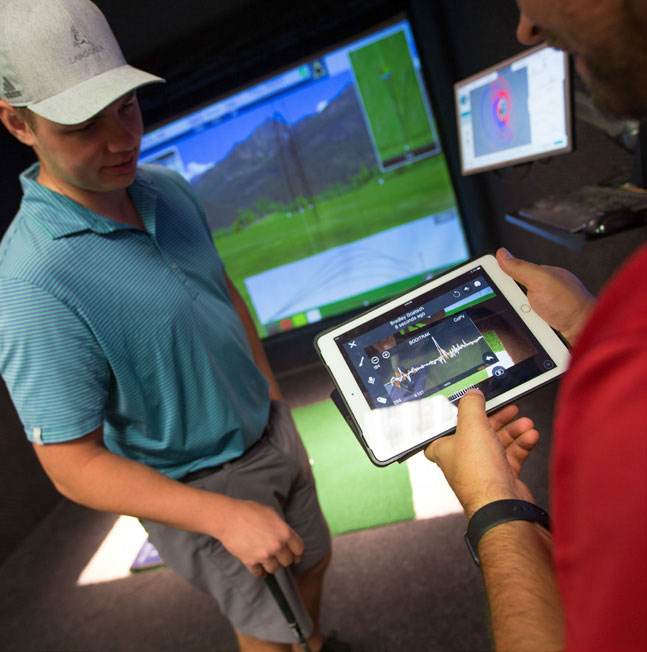 Students in a golf simulation room