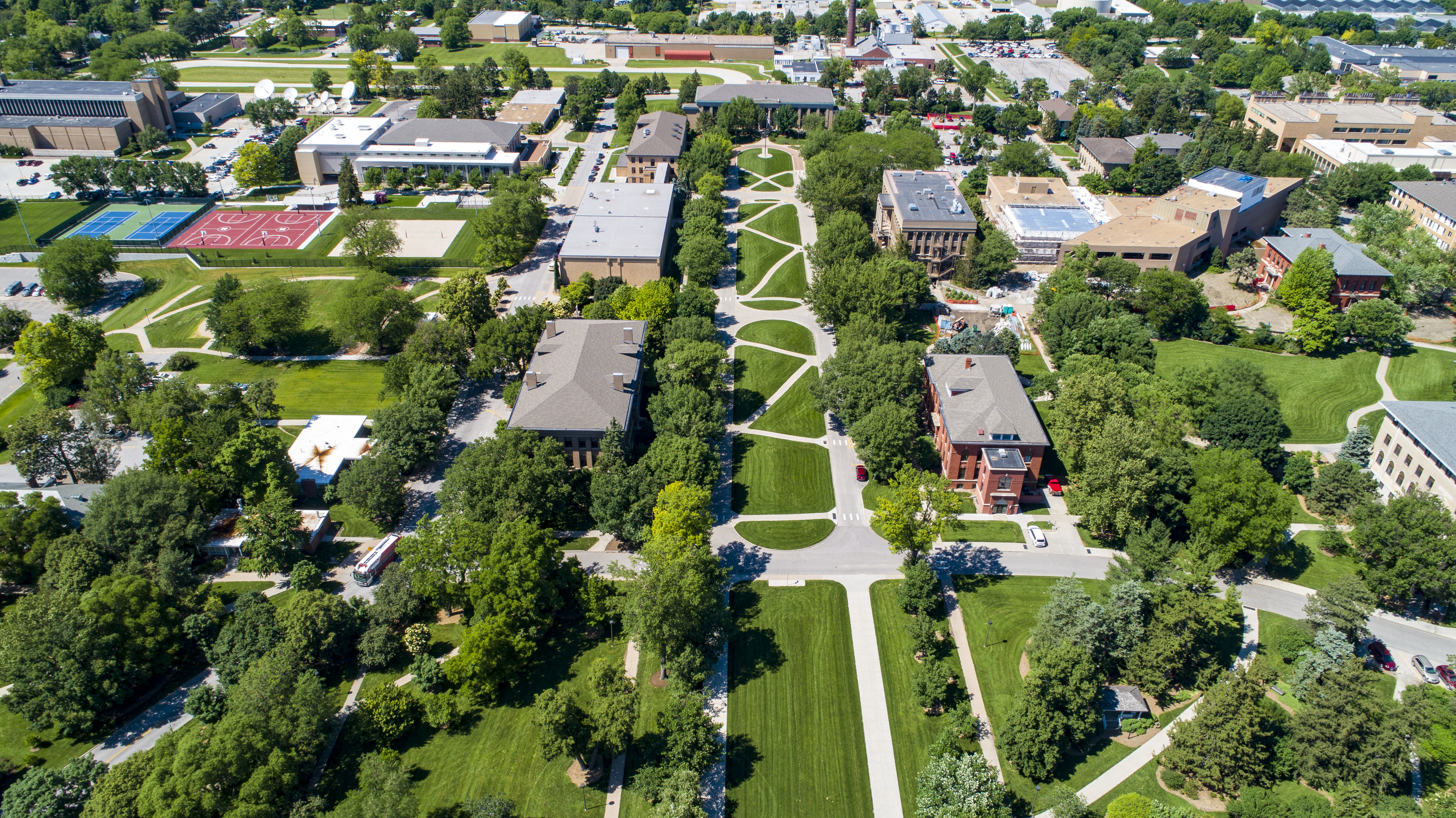 Drone footage over East Campus captures green grass and trees during the summer