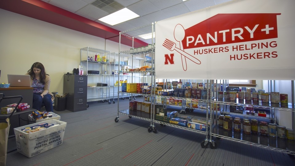 Female students works at the Helping Huskers Pantry