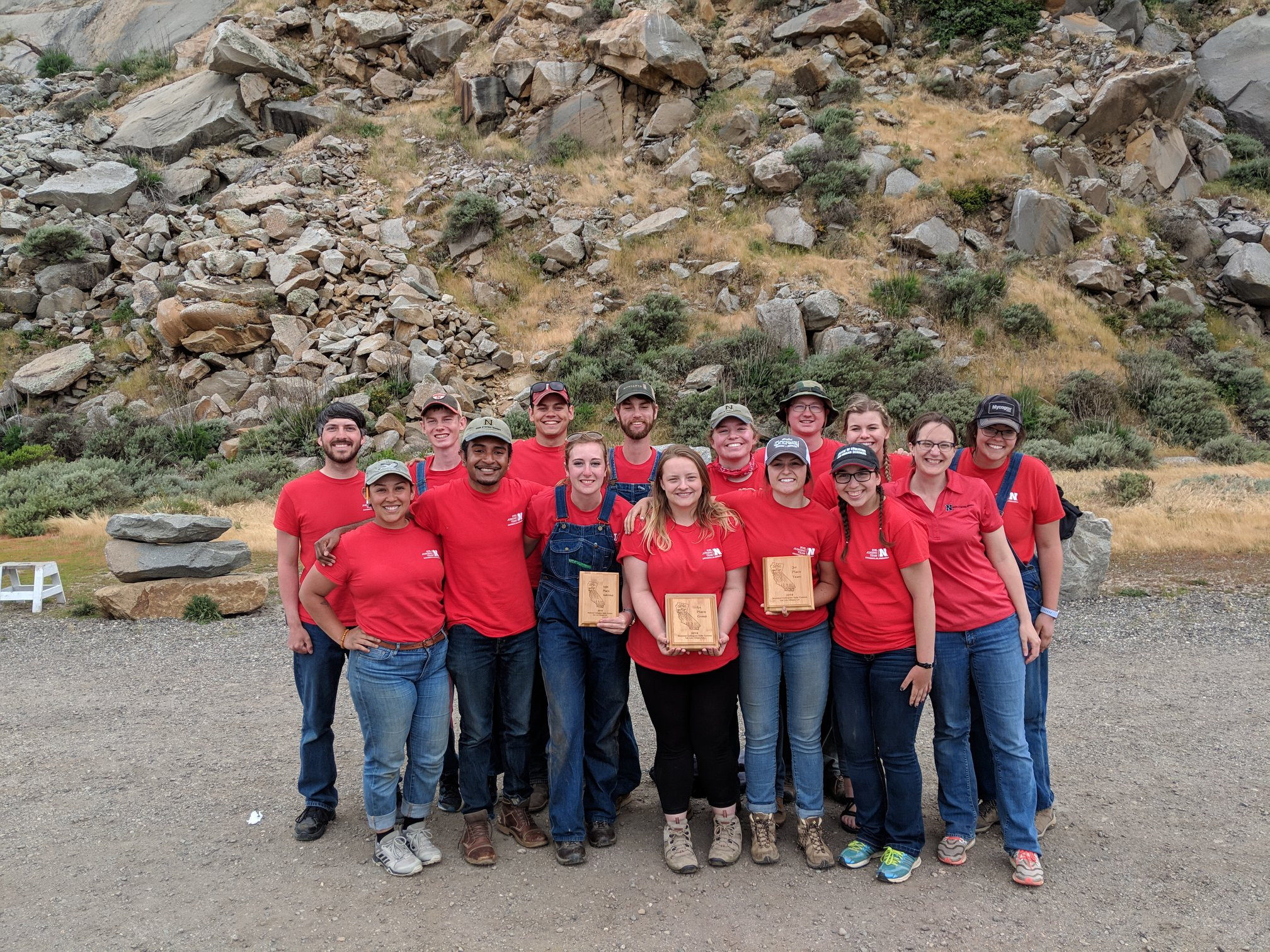 The UNL Soil Judging team holds their awards in California
