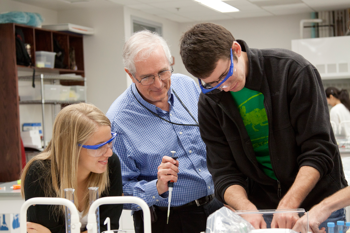 Biochemistry students conducting research with the department chair.
